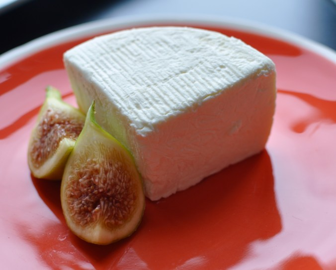 Plate of fresh Brillat-Savarin with fresh figs.