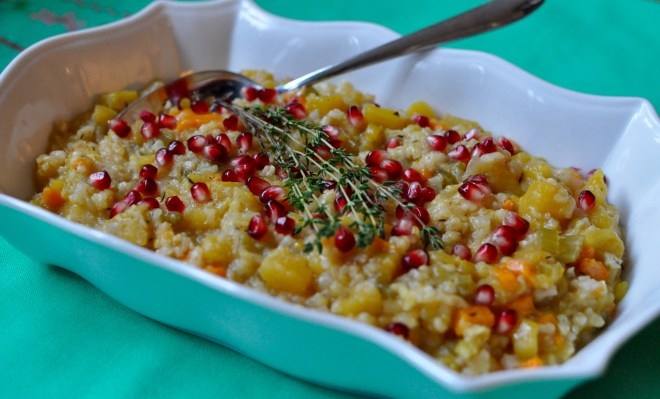 Serving dish full of acorn squash risotto with pomegranates.