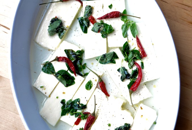 Sliced Halloumi Marinating in Lemon Juice, Olive Oil, Bird's Eye Chilies, and Fresh Oregano