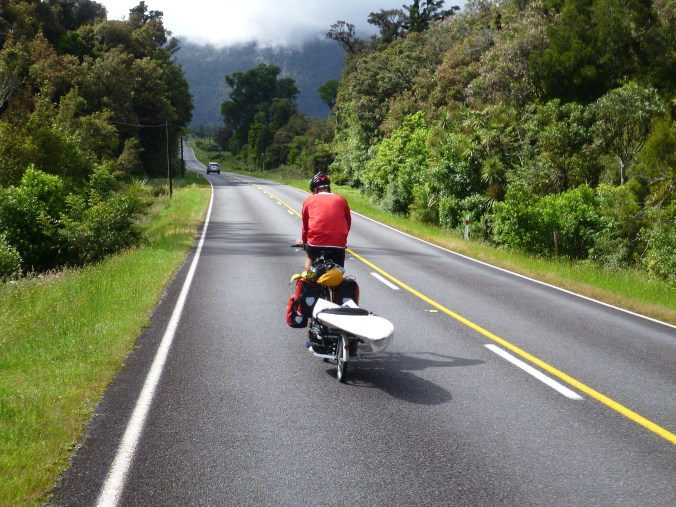 South of Haast. Swiss Tomas with his full pack (including surfboard)