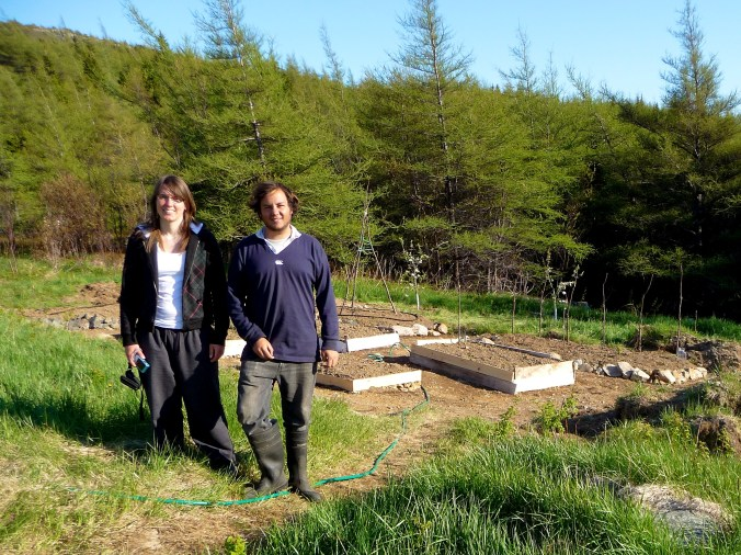 Sabrina and I and our farm efforts - We really just built garden beds for a fortnight.