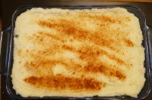 Covered with potato and a sprinkle of paprika
