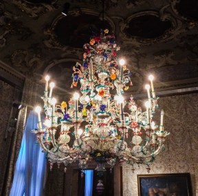 In the Brustolon Room, hangs this fabulous polychrome glass chandelier, with twenty candle holders in two orders