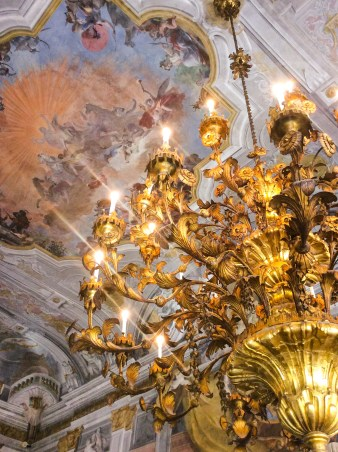 Two gilded wood and metal chandeliers, with floral motifs in the Ballroom