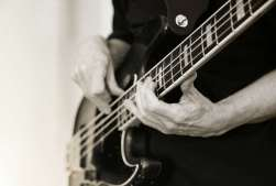 Man playing the bass during a bass lesson.