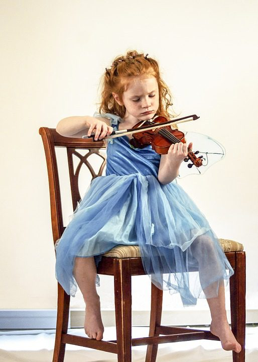 Teaching Music to children: a kid playing violin