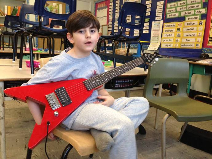 guitar lessons for 7 year old: Lucas with Flying V
