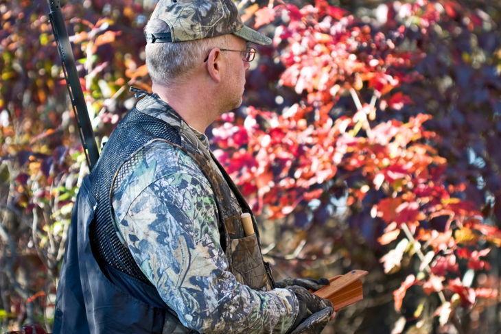 Turkey hunter working a turkey box call