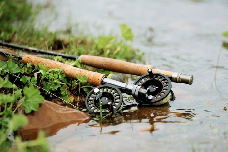 fly fishing rod with reel on the shore
