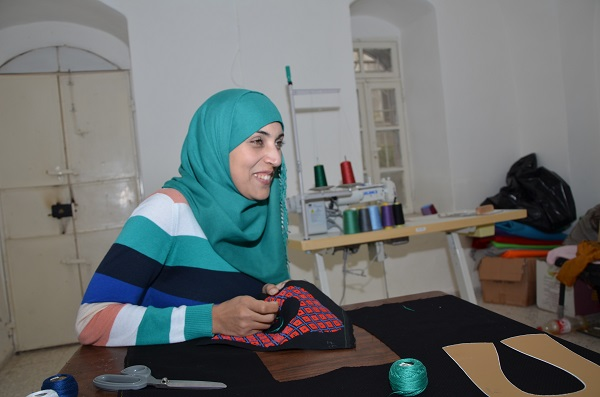 Rahaf, lead embroidery artist for the Darzah tatreez product line