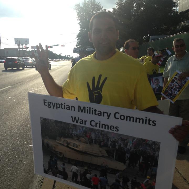 Photo of Mustafa in a pro-Rabaa Rally in the Texas.
