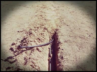 enterrando tuberías riego jardín aravaca