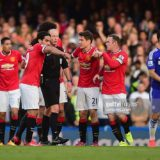 470212816-referee-mike-dean-is-surrounded-by-radamel-gettyimages[1]