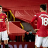 MANCHESTER, ENGLAND - FEBRUARY 06:    Harry Maguire and Bruno Fernandes of Manchester United look dejected during the Premier League match between Manchester United and Everton at Old Trafford on February 6, 2021 in Manchester, United Kingdom. Sporting stadiums around the UK remain under strict restrictions due to the Coronavirus Pandemic as Government social distancing laws prohibit fans inside venues resulting in games being played behind closed doors. (Photo by Ash Donelon/Manchester United via Getty Images)