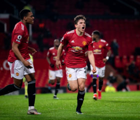 MANCHESTER, ENGLAND - FEBRUARY 21:   Daniel James of Manchester United celebrates scoring a goal to make the score 2-1 during the Premier League match between Manchester United and Newcastle United at Old Trafford on February 21, 2021 in Manchester, United Kingdom. Sporting stadiums around the UK remain under strict restrictions due to the Coronavirus Pandemic as Government social distancing laws prohibit fans inside venues resulting in games being played behind closed doors. (Photo by Ash Donelon/Manchester United via Getty Images)