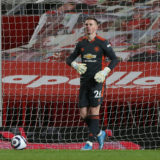 MANCHESTER, ENGLAND - MARCH 14: Dean Henderson of Manchester United in action during the Premier League match between Manchester United and West Ham United at Old Trafford on March 14, 2021 in Manchester, England. Sporting stadiums around the UK remain under strict restrictions due to the Coronavirus Pandemic as Government social distancing laws prohibit fans inside venues resulting in games being played behind closed doors.  (Photo by Matthew Peters/Manchester United via Getty Images)