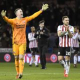 SHEFFIELD, ENGLAND - MARCH 12: Dean Henderson of Sheffield United celebrates victory after the Sky Bet Championship match between Sheffield United and Brentford at Bramall Lane on March 12, 2019 in Sheffield, England. (Photo by George Wood/Getty Images)