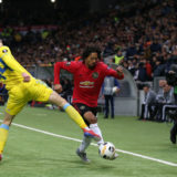 ASTANA, KAZAKHSTAN - NOVEMBER 28: D'Mani Bughail-Mellor of Manchester United in action with Yevgeny Postnikov of FK Astana during the UEFA Europa League group L match between FK Astana and Manchester United at Astana Arena on November 28, 2019 in Astana, Kazakhstan. (Photo by Matthew Peters/Manchester United via Getty Images)