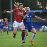 KINGSTON UPON THAMES, ENGLAND - JANUARY 17: Kirsty Hanson of Manchester United is tackled by Jonna Andersson of Chelsea during the Barclays FA Women's Super League match between Chelsea Women and Manchester United Women at Kingsmeadow on January 17, 2021 in Kingston upon Thames, England. Sporting stadiums around England remain under strict restrictions due to the Coronavirus Pandemic as Government social distancing laws prohibit fans inside venues resulting in games being played behind closed doors. (Photo by Justin Setterfield/Getty Images)