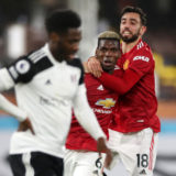 LONDON, ENGLAND - JANUARY 20: Paul Pogba of Manchester United celebrates with team mate Bruno Fernandes of Manchester United after scoring their side's second goal during the Premier League match between Fulham and Manchester United at Craven Cottage on January 20, 2021 in London, England. Sporting stadiums around the UK remain under strict restrictions due to the Coronavirus Pandemic as Government social distancing laws prohibit fans inside venues resulting in games being played behind closed doors. (Photo by Peter Cziborra - Pool/Getty Images)