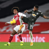 LONDON, ENGLAND - JANUARY 30: Willian of Arsenal and Fred of Manchester United battle for possession during the Premier League match between Arsenal and Manchester United at Emirates Stadium on January 30, 2021 in London, England. Sporting stadiums around the UK remain under strict restrictions due to the Coronavirus Pandemic as Government social distancing laws prohibit fans inside venues resulting in games being played behind closed doors. (Photo by Shaun Botterill/Getty Images)