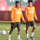 MANCHESTER, ENGLAND - FEBRUARY 08: (EXCLUSIVE COVERAGE) Shola Shoretire and Amad of Manchester United in action during a first team training session at Aon Training Complex on February 08, 2021 in Manchester, England. (Photo by Matthew Peters/Manchester United via Getty Images)