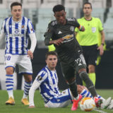 TURIN, ITALY - FEBRUARY 18: Amad of Manchester United in action with Ander Guevara of Real Sociedad during the UEFA Europa League Round of 32 match between Real Sociedad and Manchester United at Allianz Stadium on February 18, 2021 in Turin, Italy. (Photo by Matthew Peters/Manchester United via Getty Images)