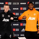 MANCHESTER, ENGLAND - MARCH 17: (EXCLUSIVE COVERAGE) Teden Mengi of Manchester United poses with Manager Ole Gunnar Solskjaer after signing a new contract with the club at Aon Training Complex on March 17, 2021 in Manchester, England. (Photo by Ash Donelon/Manchester United via Getty Images)