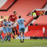 MANCHESTER, ENGLAND - MARCH 27: Lauren James of Manchester United scores her team's first goal during the Barclays FA Women's Super League match between Manchester United Women and West Ham United Women at Old Trafford on March 27, 2021 in Manchester, England. Sporting stadiums around the UK remain under strict restrictions due to the Coronavirus Pandemic as Government social distancing laws prohibit fans inside venues resulting in games being played behind closed doors.  (Photo by Clive Brunskill/Getty Images)