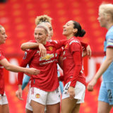 MANCHESTER, ENGLAND - MARCH 27: Christen Press of Manchester United celebrates with teammates Ella Toone, Jackie Groenen and Lauren James after scoring her team's second goal during the Barclays FA Women's Super League match between Manchester United Women and West Ham United Women at Old Trafford on March 27, 2021 in Manchester, England. Sporting stadiums around the UK remain under strict restrictions due to the Coronavirus Pandemic as Government social distancing laws prohibit fans inside venues resulting in games being played behind closed doors.  (Photo by Clive Brunskill/Getty Images)