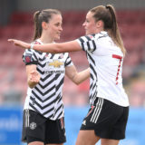 BURNLEY, ENGLAND - APRIL 18: Ella Toone of Manchester United celebrates with team mate Ona Batlle after scoring her team's second goal during the Vitality Women's FA Cup match between Burnley Women and Manchester United Women at County Ground, Leyland on April 18, 2021 in Burnley, England. Sporting stadiums around the UK remain under strict restrictions due to the Coronavirus Pandemic as Government social distancing laws prohibit fans inside venues resulting in games being played behind closed doors. (Photo by Charlotte Tattersall/Getty Images)