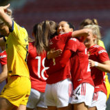 LEIGH, ENGLAND - APRIL 25: Christen Press of Manchester United celebrates with Ella Toone after scoring their side's second goal during the Barclays FA Women's Super League match between Manchester United Women and Tottenham Hotspur Women at Leigh Sports Village on April 25, 2021 in Leigh, England. Sporting stadiums around the UK remain under strict restrictions due to the Coronavirus Pandemic as Government social distancing laws prohibit fans inside venues resulting in games being played behind closed doors. (Photo by Naomi Baker/Getty Images)