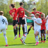 LEEDS, ENGLAND - MAY 01: Alvaro Fernandez, Charlie McNeill, Rhys Bennett, Dillon Hoogewerf of Manchester United U18s in action during the U18 Premier League match between Leeds United U18s and Manchester United U18s at LU Academy on May 01, 2021 in Leeds, England. (Photo by Manchester United/Manchester United via Getty Images)