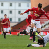 LEIGH, ENGLAND - MAY 10: Charlie McNeill of Manchester United U23s in action during the Premier League 2 match between Manchester United U23s and Derby County U23s at Leigh Sports Village on May 10, 2021 in Leigh, England. (Photo by Tom Purslow/Manchester United via Getty Images)