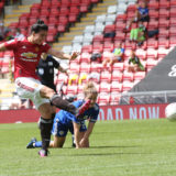LEIGH, ENGLAND - MAY 16: Jess Sigsworth of Manchester United Women scores their first goal during the Vitality Women's FA Cup 5th Round match between Manchester United Women and Leicester City Women at Leigh Sports Village on May 16, 2021 in Leigh, England. Sporting stadiums around the UK remain under strict restrictions due to the Coronavirus Pandemic as Government social distancing laws prohibit fans inside venues resulting in games being played behind closed doors.  (Photo by John Peters/Manchester United via Getty Images)