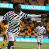 WOLVERHAMPTON, ENGLAND - MAY 23: Anthony Elanga of Manchester United celebrates scoring their first goal during the Premier League match between Wolverhampton Wanderers and Manchester United at Molineux on May 23, 2021 in Wolverhampton, England. A limited number of fans will be allowed into Premier League stadiums as Coronavirus restrictions begin to ease in the UK following the COVID-19 pandemic. (Photo by Matthew Peters/Manchester United via Getty Images)