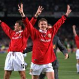 BARCELONA, SPAIN - MAY 26:  Match goalscorers Teddy Sheringham and Ole Gunnar Solskjaer of Manchester United celebrate with a treble salute after the UEFA Champions League Final between Bayern Munich v Manchester United at the Nou camp Stadium on 26 May, 1999 in Barcelona, Spain. Bayern Munich 1 Manchester United 2.  (Photo by John Peters/Manchester United via Getty Images)