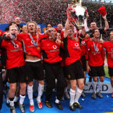 LIVERPOOL, ENGLAND - MAY 11:  The Manchester United Team celebrate winning the Premiership title after the FA Barclaycard Premiership match between Everton v Manchester United at Goodison Park on May 11, 2003 in Liverpool, England.  (Photo by John Peters/Manchester United via Getty Images)