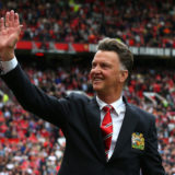 MANCHESTER, ENGLAND - AUGUST 16:  Manchester United Manager Louis van Gaal waves to the crowd prior to the Barclays Premier League match between Manchester United and Swansea City at Old Trafford on August 16, 2014 in Manchester, England.  (Photo by Alex Livesey/Getty Images)