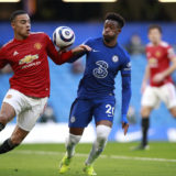 LONDON, ENGLAND - FEBRUARY 28: The ball hits the hand of Callum Hudson-Odoi of Chelsea as he is is challenged by Mason Greenwood of Manchester United which was reviewed by VAR during the Premier League match between Chelsea and Manchester United at Stamford Bridge on February 28, 2021 in London, England. Sporting stadiums around the UK remain under strict restrictions due to the Coronavirus Pandemic as Government social distancing laws prohibit fans inside venues resulting in games being played behind closed doors. (Photo by Ian Walton - Pool/Getty Images)
