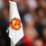 MANCHESTER, ENGLAND - AUGUST 14: Detailed view of the Manchester United club badge on a corner flag during the Premier League match between Manchester United  and  Leeds United at Old Trafford on August 14, 2021 in Manchester, England. (Photo by Catherine Ivill/Getty Images,)