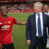 MANCHESTER, ENGLAND - JUNE 04:  Manager Sir Alex Ferguson of Manchester United '08 XI speaks to Patrice Evra after the Michael Carrick Testimonial match between Manchester United '08 XI and Michael Carrick All-Stars at Old Trafford on June 4, 2017 in Manchester, England.  (Photo by John Peters/Manchester United via Getty Images)