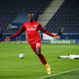 SALZBURG, AUSTRIA - SEPTEMBER 30: Patson Daka of RB Salzburg celebrates after scoring his sides third goal during the UEFA Champions League Play-Off second leg match between RB Salzburg and Maccabi Tel-Aviv at Red Bull Arena on September 30, 2020 in Salzburg, Austria. Football Stadiums around Europe remain empty due to the Coronavirus Pandemic as Government social distancing laws prohibit fans inside venues resulting in fixtures being played behind closed doors. (Photo by Adam Pretty/Getty Images)