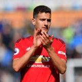 Manchester United's Diogo Dalot applauds the fans after the final whistle of the Premier League match at the John Smith's Stadium, Huddersfield.