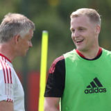 MANCHESTER, ENGLAND - JULY 26: (EXCLUSIVE COVERAGE) Manager Ole Gunnar Solskjaer and Donny van de Beek of Manchester United in action during a first team training session at Carrington Training Ground on July 26, 2021 in Manchester, England. (Photo by Matthew Peters/Manchester United via Getty Images)