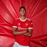 MANCHESTER, ENGLAND - AUGUST 16: (EXCLUSIVE COVERAGE) Raphael Varane of Manchester United poses after signing for the club at Carrington Training Ground on August 16, 2021 in Manchester, England. (Photo by Manchester United/Manchester United via Getty Images)