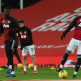 MANCHESTER, ENGLAND - NOVEMBER 21: Axel Tuanzebe and Brandon Williams of Manchester United warms up ahead of the Premier League match between Manchester United and West Bromwich Albion at Old Trafford on November 21, 2020 in Manchester, England. Sporting stadiums around the UK remain under strict restrictions due to the Coronavirus Pandemic as Government social distancing laws prohibit fans inside venues resulting in games being played behind closed doors. (Photo by Matthew Peters/Manchester United via Getty Images)