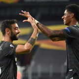 COLOGNE, GERMANY - AUGUST 16: Bruno Fernandes of Manchester United  celebrates with Marcus Rashford  after scoring his team's first goal from the penalty spot during the UEFA Europa League Semi Final between Sevilla and Manchester United at RheinEnergieStadion on August 16, 2020 in Cologne, Germany. (Photo by Ina Fassbender/Pool via Getty Images)