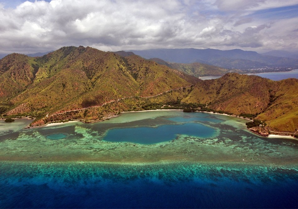 Aerial views of the approach to Dili, Timor-Leste.   Top 10 Backpacking Destinations Around the World