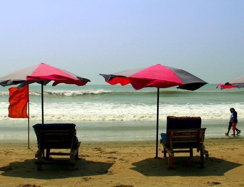 Row of sunshade and deck chairs on Cox's Bazar Beach in Bangladesh | 10 Spectacular Places to Visit Before They Become Famous